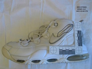 This undated photo provided by the Phoenix Police Department shows a tennis shoe with markings on it made by the Phoenix police that is among the evidence police are using to link Mark Goudeau to the city's Baseline Killer investigation, according to reports obtained by The Associated Press. Police seized the shoe and other items during a search of Goudeau's central Phoenix home in October last year. The items either contained DNA evidence that matched murder victims' blood or were items the victims owned. Goudeau's lawyers deny that he's the notorious Baseline Killer, a serial predator that police say terrorized Phoenix from 2005 to 2006 with a string of random attacks. He has pleaded not guilty to 74 criminal counts, including nine counts of first-degree murder, 15 counts of sexual assault and 11 counts of kidnapping. (AP Photo/Phoenix Police Department)
